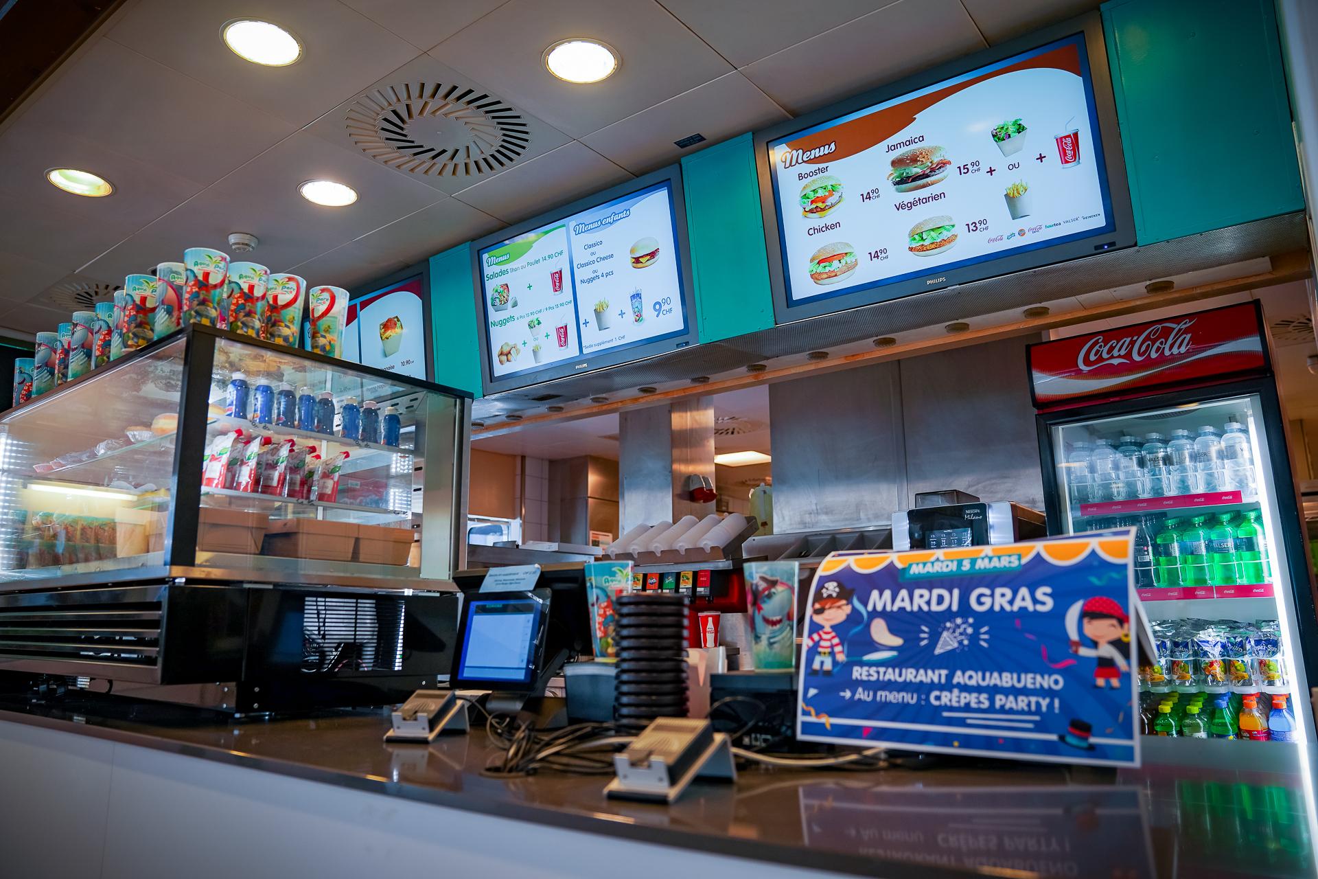 Ecrans avec digital signage/affichage dynamique pour restaurant.